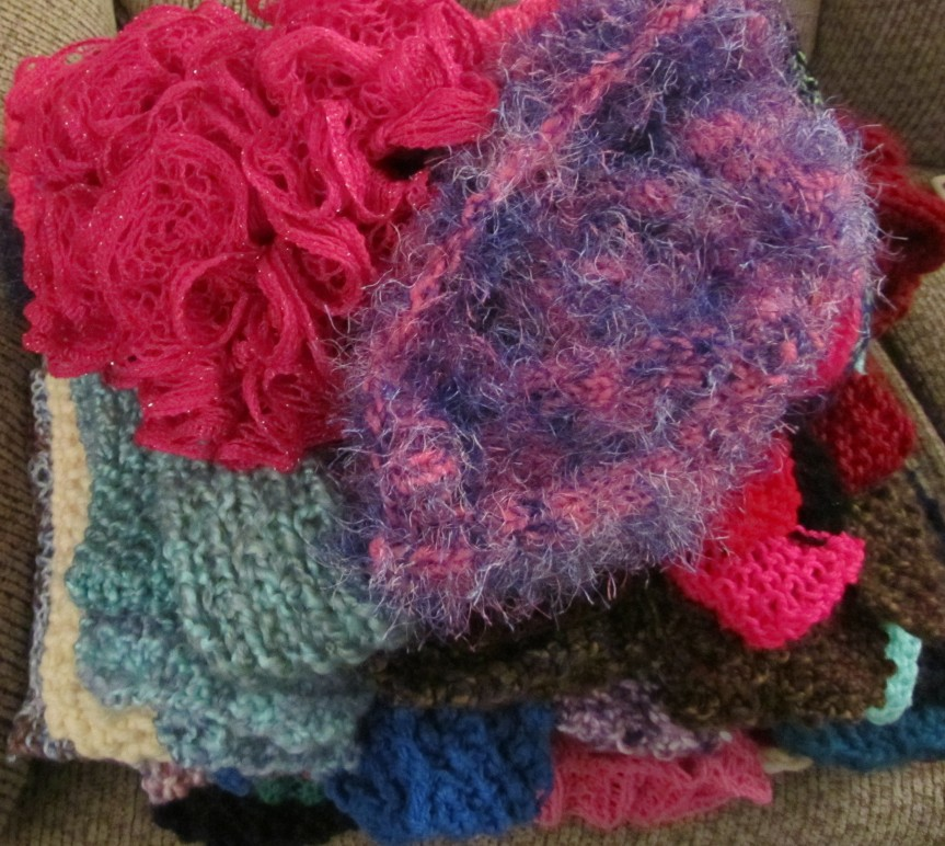 Pile of scarves and hats ready to be scarf-bombed by WUL!