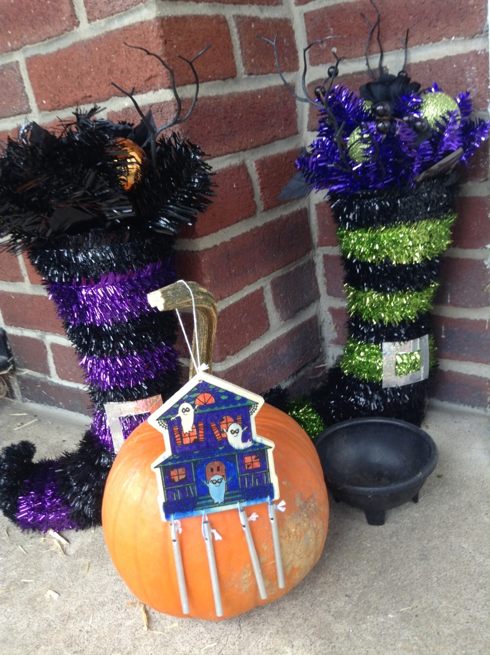 Sparkly witches boots, and a pumpkin with a windchime.